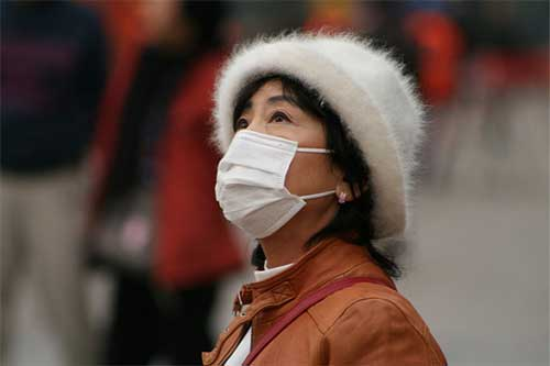 Chinese woman in face mask